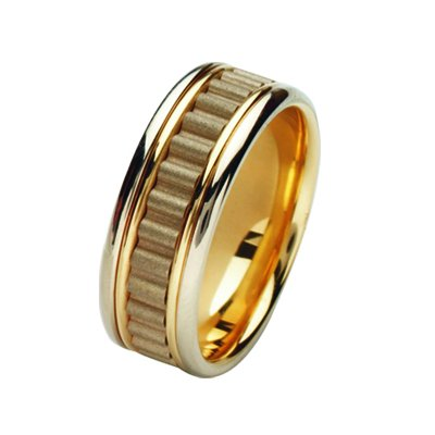Item # 211431E - 18Kt Two-tone wedding band. The ring is about 8.0 mm wide and comfort fit. There is a unique design in the center which is a coarse sandblast finish. The outer edges are polished. Different finishes may be selected or specified.