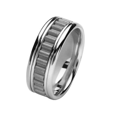 Item # 211431WE - 18Kt White gold wedding band. The ring is about 8.0 mm wide and comfort fit. There is a unique design in the center which is a coarse sandblast finish. The outer edges are polished. Different finishes may be selected or specified.
