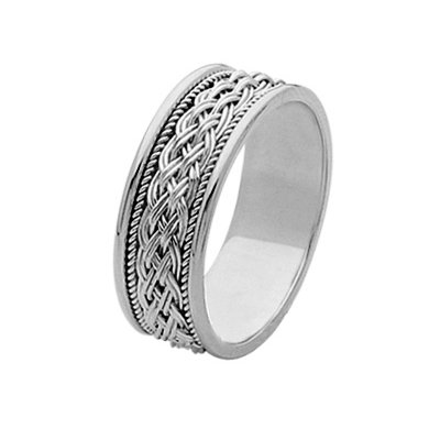 Item # 211531WE - 18Kt White gold hand made braided wedding band. The ring is about 8.0 mm wide and comfort fit. There is one unique hand crafted braid in the center. On each side of the braid is one hand made rope. The whole ring is polished. Different finishes may be selected or specified.