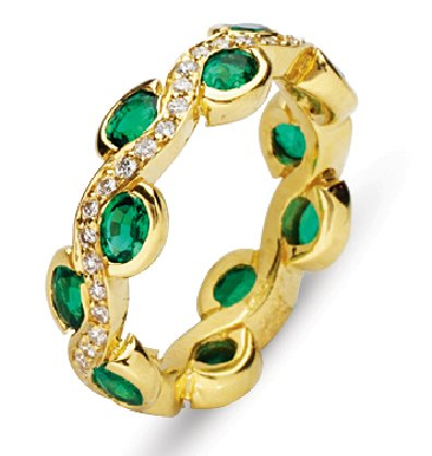 Item # 211963E - 18K gold diamond emerald eternity band. The ring holds 11 oval shape matching emeralds with total weight approximately 2.75ct and 1.0 ct total weight round brilliant cut diamonds. The emerald all are very fine quality and matching in colors. Diamonds are graded as VS in clarity G-H in color.