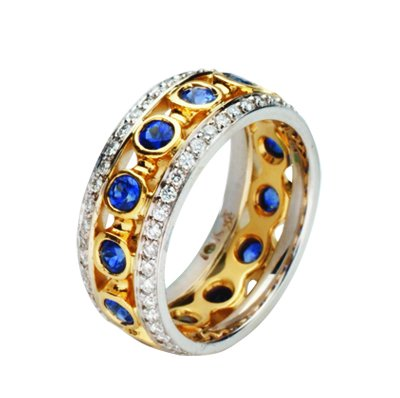 Item # 212071E - 18Kt two-tone gold blue sapphire and diamond ring. The ring has approximately a total weight of 0.63ct sapphires and 0.33ct diamonds, VS1-2 in clarity and G-H in color. The whole ring is polished. Different finishes may be selected or specified.