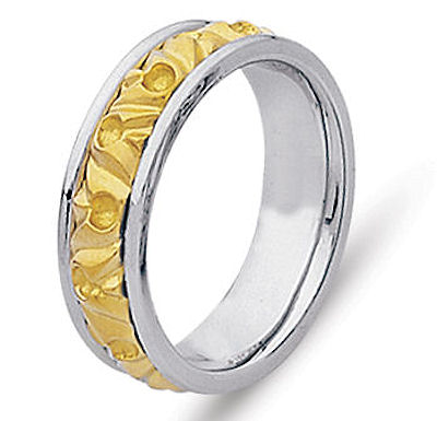 Item # 21303 - Hand crafted, 14 kt two-tone comfort fit band. The ring is beautifully designed around old motifs. It is approximately 8.0 mm wide. The center is a matte finish and the outer edges are polished. Different finishes may be selected or specified.