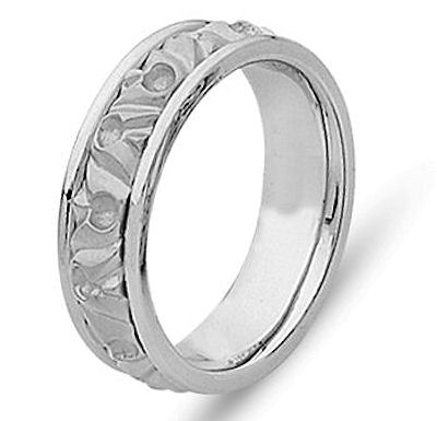 Item # 21303WE - Hand crafted, 18 kt white gold comfort fit band. The ring is beautifully designed around old motifs. It is approximately 8.0 mm wide. The center is a matte finish and the outer edges are polished. Different finishes may be selected or specified.