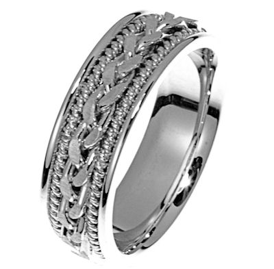 Item # 21397WE - Hand crafted, 18kt white gold comfort fit band. There is a hand made braid in the center. Two channels of 18 kt white gold twisted wires completes the ring. The whole ring is polished. Different finishes may be selected or specified.