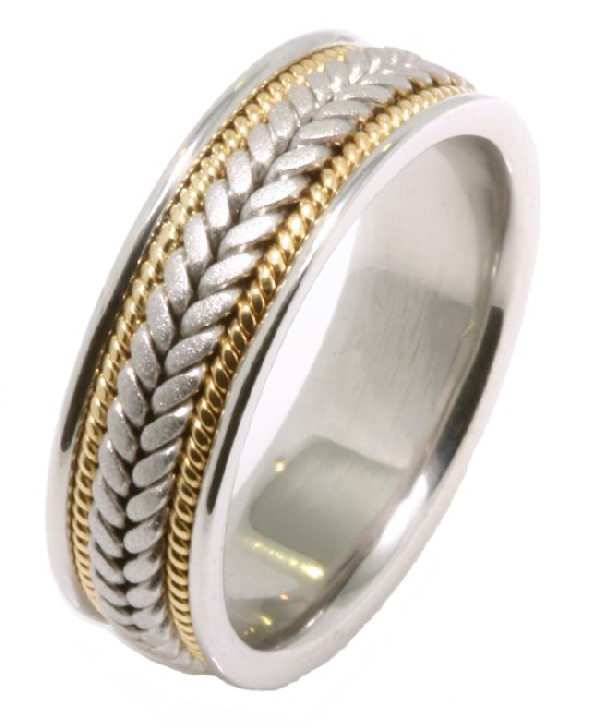 Item # 21398E - Hand crafted, 18kt two-tone gold comfort fit band. Two channels of 18 kt yellow gold twisted wires completes the ring. The center of the ring is matte and the outer edges are polished. Different finishes may be selected or specified.