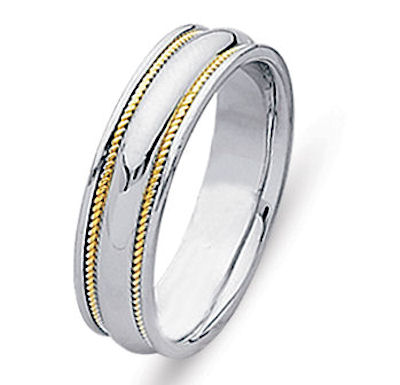 Item # 21400PE - Hand crafted, platinum and 18 kt yellow gold comfort fit band. Two channels of 18 kt yellow gold twisted wires completes the ring. The whole ring is polished. Different finishes may be selected or specified.