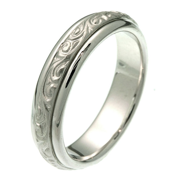 Item # 214041WE - 18 kt white gold 5.5 mm wide comfort fit wedding band. The ring has beautiful hand carved motifs in the center that is a matte finish and the edges are polished. It is 5.5 mm wide and comfort fit. Different finishes may be selected or specified.