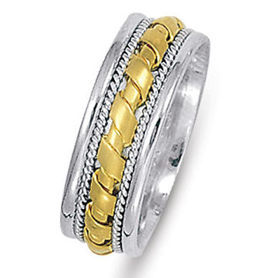 Item # 21474PE - Hand crafted, platinum and 18 kt yellow gold comfort fit band. The ring is 7.0 mm wide. It has twisted platinum wires and accent of 18 kt yellow gold. The yellow gold potion is matte finish and the platinum portion is high polished. Different finishes may be selected or specified.