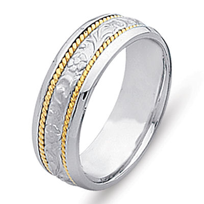 Item # 21491 - 14 kt two-tone gold hand carved, 6.0 mm wide comfort fit Celtic wedding band. The ring has hand carved 14 kt white gold designs and two twisted ropes in 14 kt yellow gold. The center is matte and the rest is polished. Different finishes may be selected or specified.