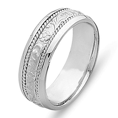 Item # 21491W - 14 kt white gold hand carved, 6.0 mm wide comfort fit Celtic wedding band. The ring has hand carved 14 kt white gold designs and two twisted ropes made in 14 kt white gold. The center is matte finish and the rest is polished. Different finishes may be selected or specified.