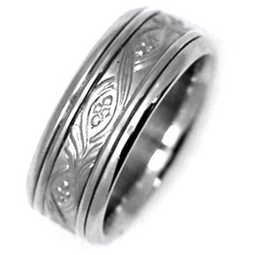 Item # 21492W - Hand crafted, 14K white gold, 8.0 mm wide comfort fit Celtic wedding band. Hand crafted with beautiful motifs. The center is matte and the rest is polished. Different finishes may be selected.