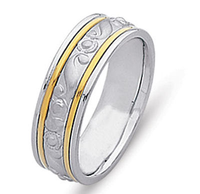 Item # 21493 - Hand crafted, 14 kt two-tone comfort fit band. An accent of 14 kt yellow gold wires and beautiful motifs crafted in the white gold. The center is matte and the rest is polished. Different finishes may be selected or specified.