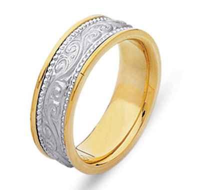 Item # 21497E - Hand crafted, 18 kt two-tone gold comfort fit band. The ring has beautiful hand crafted engraving in the center and is a matte finish. The outer edges are polished. Different finishes may be selected or specified.