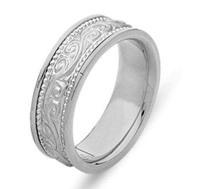 Item # 21497WE - Hand crafted, 18 kt white gold comfort fit band. The ring has beautiful hand crafted engraving in the center and is a matte finish. The outer edges are polished. Different finishes may be selected or specified.
