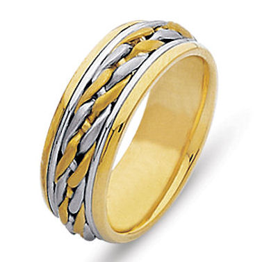 Item # 21502E - Hand crafted, 18 kt two-tone comfort fit band. The 18 kt yellow gold and white gold are intertwined to create a beautiful braid. The finish is polished. Different finishes may be selected or specified.