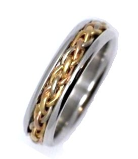 Item # 21520E - 18K two-tone white and yellow gold, comfort fit, hand made, 6.0 mm wide wedding ring. There is a hand made braid in the center. The whole ring is polished. Different finishes may be selected or specified.