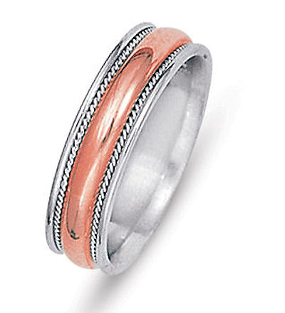 Item # 21528RE - Hand crafted, 18 kt rose and white gold comfort fit band. The ring is 6.0 mm wide. There are two hand made ropes in the center of the ring. The finish on the ring is polished. Different finishes may be selected or specified.