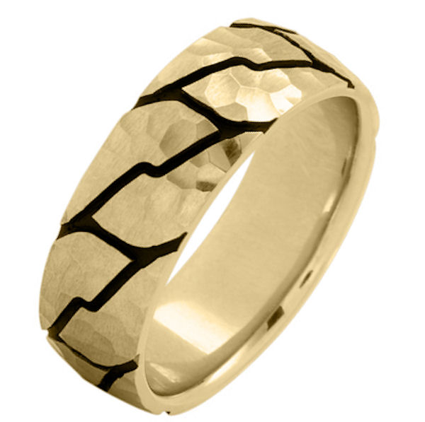 Item # 215897E - 18 Kt Yellow gold, comfort fit, 8.0 mm wide, carved wedding ring. The ring has a carved pattern with black antique and a hammered pattern. The ring is brushed finish. Other finishes may be selected or specified.