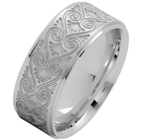 Item # 216146WE - 18 Kt White gold, comfort fit, 8.5 mm wide, carved wedding ring. The ring has a carved pattern in the center that is brush finish. Outer edges are polished. Other finishes may be selected or specified.