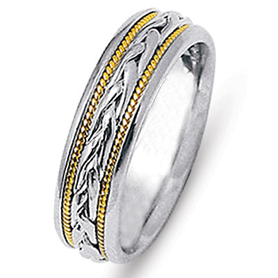 Item # 21646E - 18 kt two-tone hand crafted 6.0 mm wide comfort fit wedding band. The ring has two 18 kt yellow gold ropes and a beautiful braid made in 18 kt white gold. The finish is all polished. Different finishes may be selected or specified.