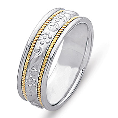 Item # 21699PE - Platinum and 18 kt yellow gold hand carved 6.0 mm wide, comfort fit wedding band. The ring is hand carved in platinum with unique designs and two twisted ropes in 18 kt yellow gold. The center is matte finish and the rest is polished. Different finishes may be selected or specified.