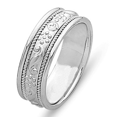 Item # 21699WE - 18 kt white gold hand carved 6.0 mm wide, comfort fit wedding band. The ring is hand carved in 18 kt white gold with unique designs and two twisted ropes in 18 kt white gold. The center is matte finish and the rest is polished. Different finishes may be selected or specified.