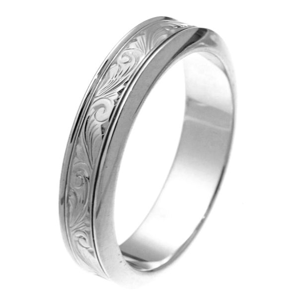 Item # 218001W - 14 kt white gold 5.5 mm wide hand carved comfort fit wedding band. The ring has hand carving in the center with a polished finish. It is 5.5 mm wide and comfort fit. Different finishes may be selected or specified.
