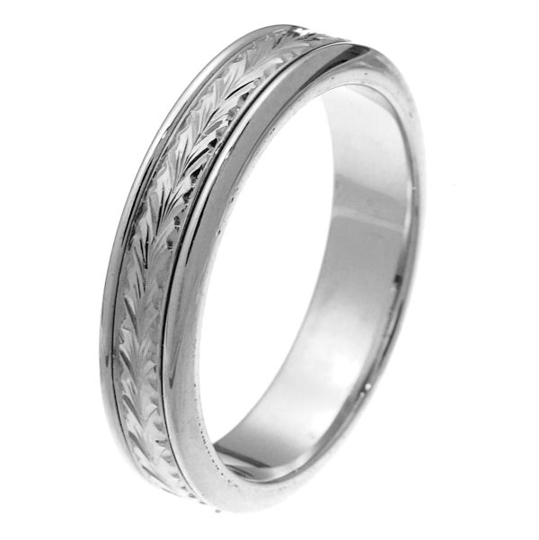 Item # 218031WE - 18 kt white gold 5.0 mm wide comfort fit wedding band. The center of the ring has hand carving with an all polished finish. It is 5.0 mm wide and comfort fit. Different finishes may be selected or specified.