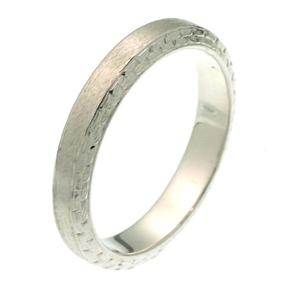 Item # 218081PP - Platinum 3.5 mm wide comfort fit wedding band. The ring has hand carvings on the each side of the band. It is 3.5 mm wide and comfort fit. The finish is matte. Different finishes may be selected or specified.