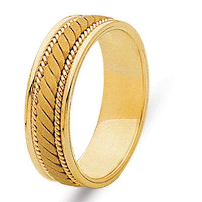 Item # 21996E - Hand crafted 18 kt yellow gold 6.0 mm wide, comfort fit wedding band. The ring has a sandblast finish in the center and the rest is polished. Different finishes may be selected or specified.
