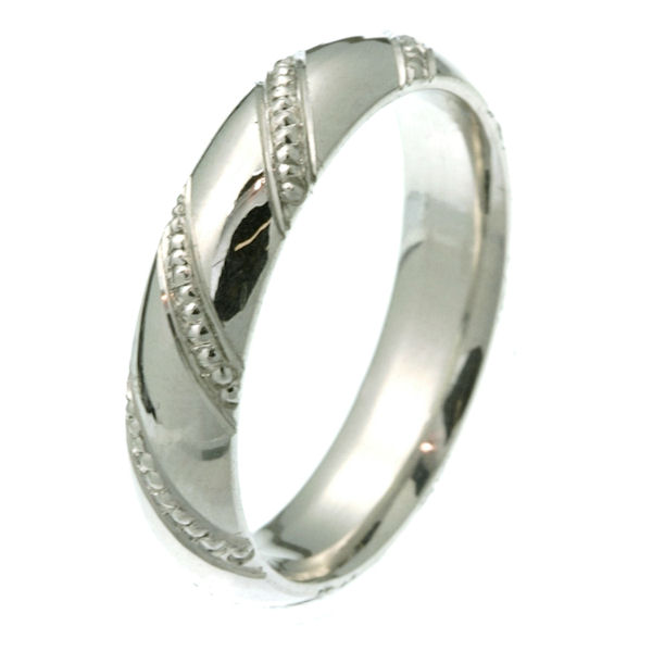 Item # 2214662WE - 18 kt white gold 5.0 mm wide comfort fit wedding band. The ring has milgrain rows diagonal on the band. It is all polished, 5.0 mm wide and comfort fit. Different finishes may be selected or specified.