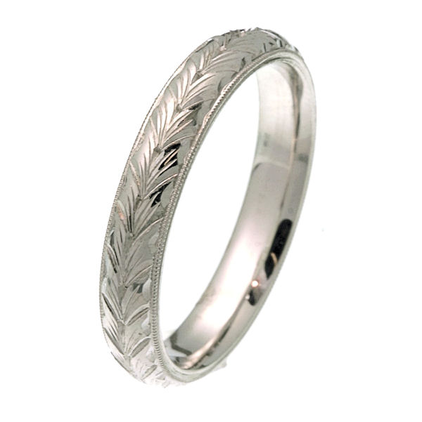 Item # 2214672WE - 18 kt white gold 4.0 mm wide hand carved comfort fit wedding band. The ring has hand carving in the center with a milgrain edge. It is 4.0 mm wide and comfort fit. The finish is polished. Different finishes may be selected or specified.