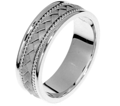 Item # 22206WE - 18 Kt white gold hand crafted ring. The braid is all 18 kt white gold and has a sandblasted finish. The ring is 6.0 mm wide and comfort fit. The finish on the edges are polished. Different finishes may be selected or specified.