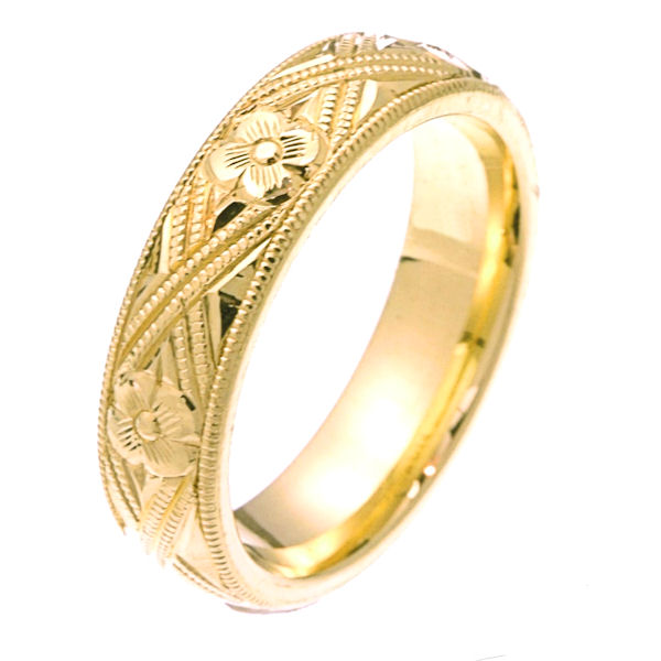 Item # 2228971 - 14 kt yellow gold hand carved comfort fit 5.0 mm wide wedding band. The yellow gold is hand carved with milgrains and flowers. It is 5.0 mm wide and a polished finish. Different finishes may be selected or specified.