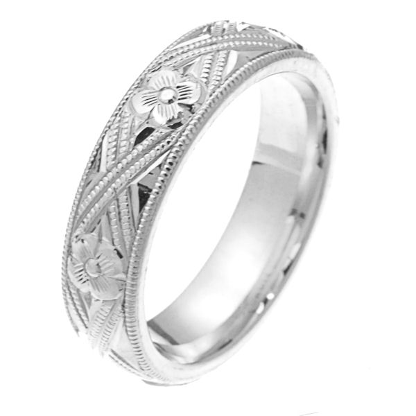 Item # 2228971WE - 18 kt white gold hand carved comfort fit 5.0 mm wide wedding band. The white gold is hand carved with milgrains and flowers. It is 5.0 mm wide and a polished finish. Different finishes may be selected or specified.