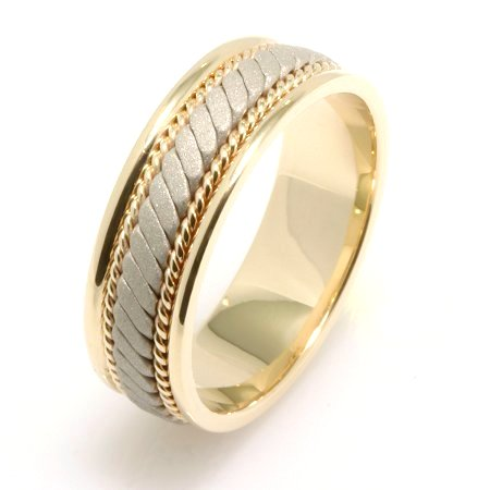 Item # 22470 - 14 K two tone, white and yellow gold, comfort fit, 7.0 mm wide, hand crafted, wedding band. There is a hand made rope design in the center with one hand crafted rope on each side of the design. The finish in the center is a sandblasted matte and the outer edges are polished. Different finishes may be selected or specified.