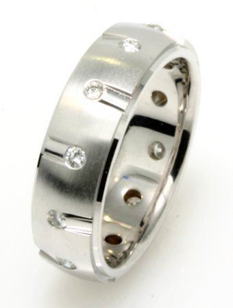 Item # 234829W - 14K white gold, 6.7 mm wide, comfort fit wedding band. The wedding band holds 12 round brilliant cut diamonds with total weight of 0.40ct. The diamonds are graded as VS in clarity G-H in color. The center is matte and the outer edges of the ring are polished. Different finishes may be selected or specified.