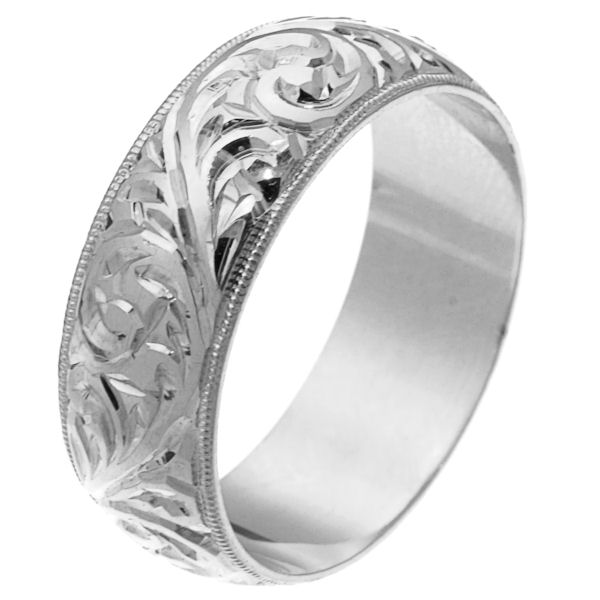 Item # 2516578WE - 18 kt white gold hand carved comfort fit 8.0 mm wedding band. The white gold is hand carved with beautiful motifs with milgrain edges. It is 8.0 mm wide and comfort fit. The finish is polished. Different finishes may be selected or specified.