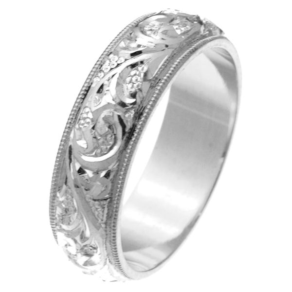 Item # 2616576W - 14 kt white gold hand carved comfort fit 6.0 mm wedding band. The white gold is hand carved with beautiful motifs and the milgrain edge is white gold. It is 6.0 mm wide and comfort fit. The finish is polished. Different finishes may be selected or specified.