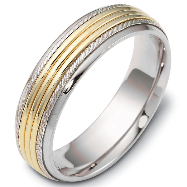 Item # 46833PE - Platinum and 18kt yellow gold classic, comfort fit, 6.0mm wide wedding band. The ring has carvings near the edges. It has a polished finish. Different finishes may be selected.