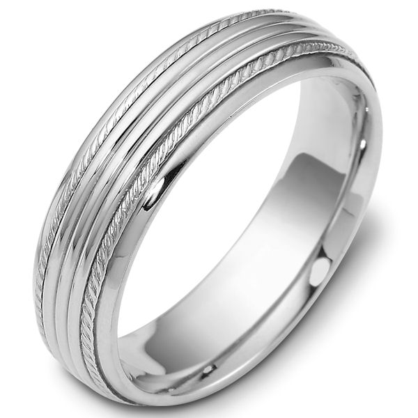 Item # 46833W - 14kt White gold classic, comfort fit, 6.0mm wide wedding band. The ring has carvings near the edges. It has a polished finish. Different finishes may be selected.