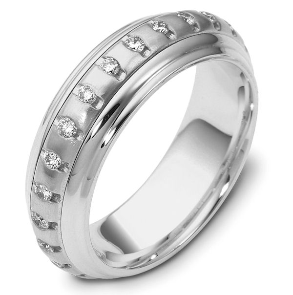 Item # 46921WE - 18kt White gold diamond spinning, eternity, comfort fit, 6.5mm wide wedding band. The ring has 0.50 ct tw diamonds that are VS1-2 in clarity and G-H in color. There are 25 round brilliant cut diamonds, each measures 0.02 ct. The center portion of the ring has a matte finish and the edges are polished. Different finishes may be selected or specified.