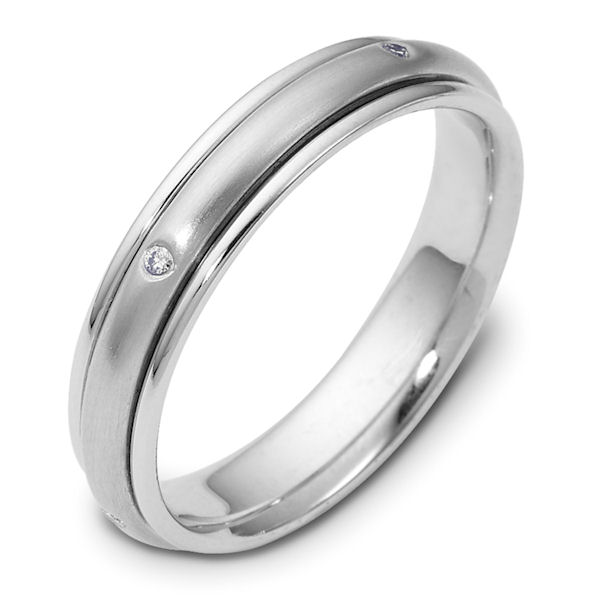 Item # 46937WE - 18kt White gold diamond spinning, comfort fit, 4.0mm wide wedding band. The ring has 0.05 ct tw diamonds that are VS1-2 in clarity and G-H in color. There are 5 round brilliant cut diamonds, each measures 0.01 ct. The center portion of the ring rotates and has a matte finish. The edges are polished. Different finishes may be selected or specified.