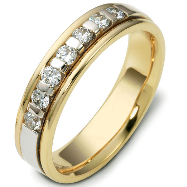 Item # 47243E - 18kt Two-tone gold diamond, comfort fit, 4.5mm wide wedding band. The ring has approximately 0.28 ct tw diamonds, VS1-2 in clarity and G-H in color. There are 7 round brilliant cut diamonds and each measures about 0.04 ct. It is 4.5mm wide and comfort fit. The center is brushed and the rest of the ring is polished. Other finishes may be selected or specified.