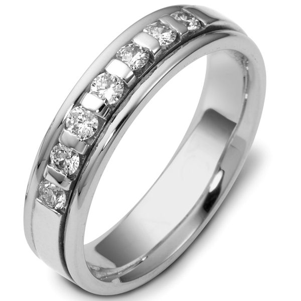 Item # 47243W - 14kt White gold diamond, comfort fit, 4.5mm wide wedding band. The ring has approximately 0.28 ct tw diamonds, VS1-2 in clarity and G-H in color. There are 7 round brilliant cut diamonds and each measures about 0.04 ct. It is 4.5mm wide and comfort fit. The center is brushed and the rest of the ring is polished. Other finishes may be selected or specified.