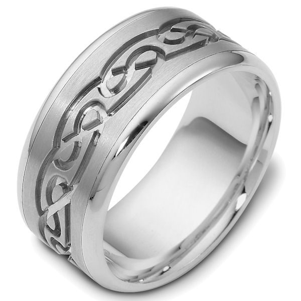 Item # 47541WE - 18kt White gold celtic carved, comfort fit, 9.5mm wide wedding band. The ring has a beautiful celtic pattern carved around whole band with a matte finish in the center and polish finish on the edges. It is 9.5mm wide and comfort fit.