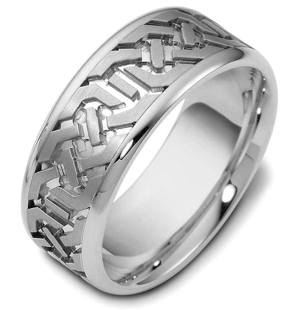Item # 47542W - 14kt White gold contemporary carved, comfort fit, 8.5mm wide wedding band. The ring has a beautiful carved pattern around the whole band with a matte finish in the center and polish finish on the edges. It is 8.5mm wide and comfort fit.