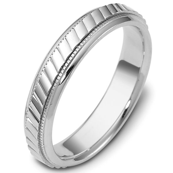 Item # 47555WE - 18kt White gold classic, comfort fit, 5.0mm wide wedding band. The ring has a carved pattern in the center that has a polished finish. On each side of the center carving is a milgrain edge. The edges are polished. Different finishes may be selected or specified.