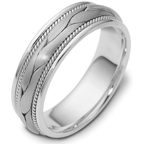 Item # 47567WE - 18kt White gold handcrafted, comfort fit, 6.5mm wide wedding band. The ring has a beautiful hand crafted braid in the center that has a matte finish. Next to the hand crafted braid is one rope on each side. Different finishes may be selected or specified.