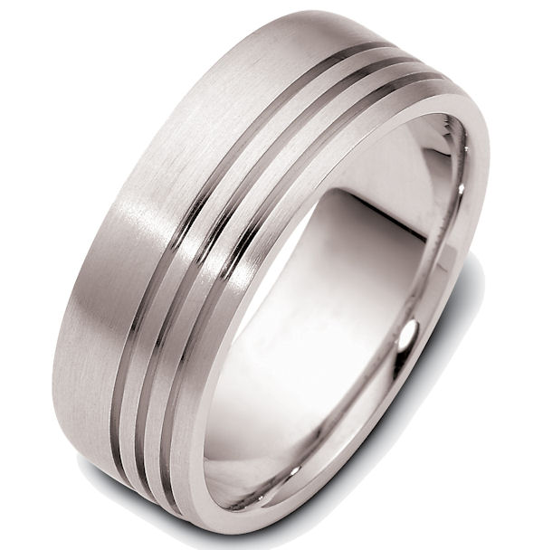 Item # 47693W - 14kt White gold classic carved, comfort fit, 8.0mm wide wedding band. The ring has 3 straight carved lines around the whole band with a matte finish. It is 8.0mm wide and comfort fit.